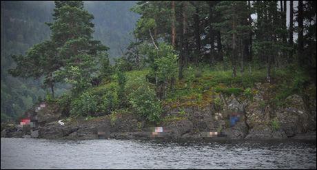 STERKE INNTRYKK: Det ligger flere tilsynelatende døde personer langs strendene på Utøya. Det er ikke klart om de er døde. Mange er også kraftig nedkjølt etter å ha svømt i vannet. Bildet er sladdet av VG Nett. Foto: VEGARD M. AAS / PRESSE30.NO