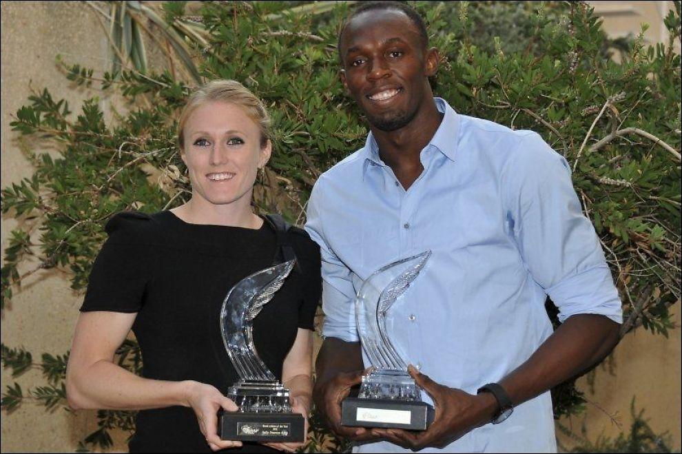 ÅRETS FRIIDRETTSUTØVERE: Sally Pearson og Usain Bolt ble lørdag kåret til årets friidrettsutøvere. Foto: Reuters