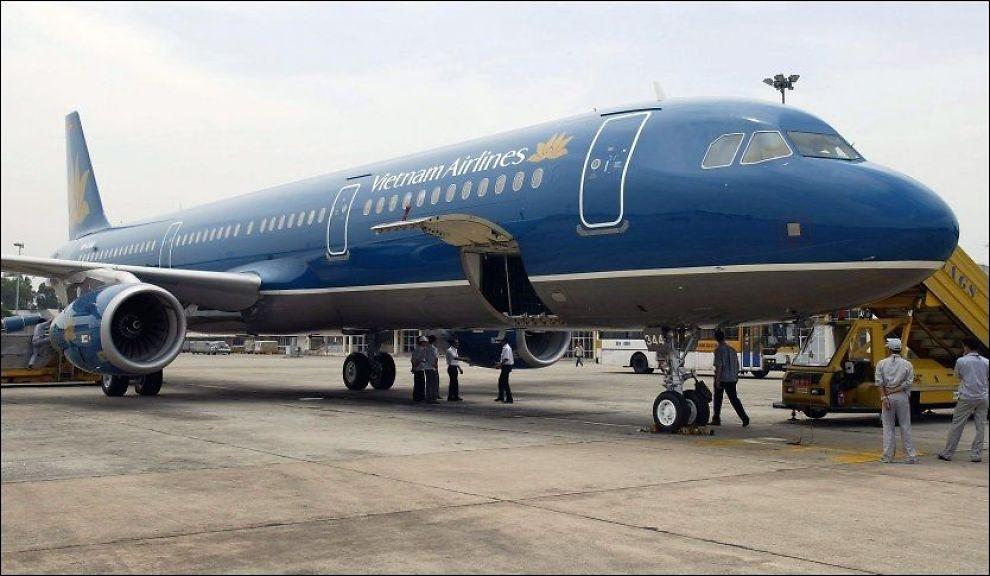 NØDNE PASSASJERER:Vietnam Airlines har problemer med passasjerer som åpner nødutgangen. Foto: AFP