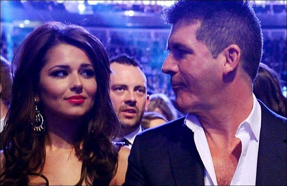 IKKE VENNER MER: Cheryl Cole og Simon Cowell på et bilde fra i fjor - før vennskapet surnet. Foto: PA