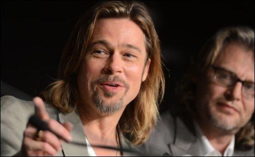 ÅPEN: På spørsmål om det blir bryllup i sommer, hevdet Pitt at det ikke er bestemt. Foto: AFP