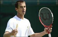 Nadals overmann ute av Wimbledon