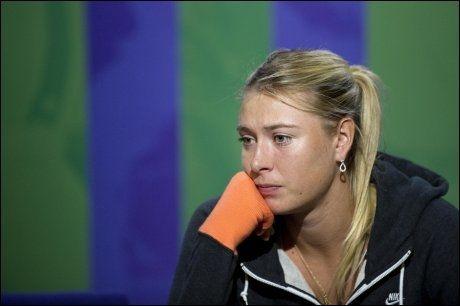 HOLDT MUNN: Det var ikke mye en skuffet Maria Sjarapova sa på pressekonferansen etter tapet. Foto: Pa