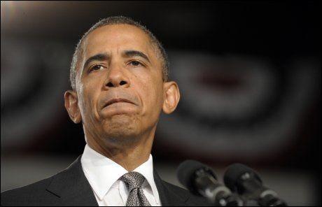 UTTRYKE MEDFØLELSE: President i USA, Barack Obama, avbrøt ferien sin i Florida etter massakren i Aurora i Colorado. Han uttrykte medfølelse med ofrene i en tale fredag ettermiddag norsk tid. FOTO: AP