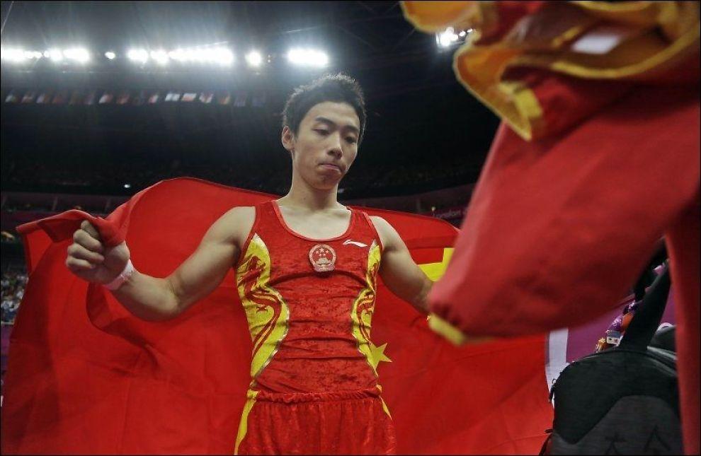 OL-VINNER: Zou Kai (24) begynte med turn da han var fire år gammel. Nå har han fem gullmedaljer fra OL. Foto: AP