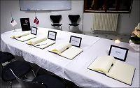 Kister med norske terrorofre på vei hjem