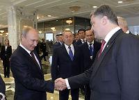 Putin skyver ansvaret for en løsning over på Ukraina