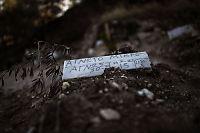 Druknede flyktninger legges i anonyme graver