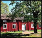 LANDLIG: Åland er røde stugor i vakker natur - som her langs postveien ved Jan Karlsgården i Sund. Foto: Dag Fonbæk. Foto: