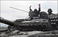 Georgia trekker tilbake halve Irak-styrken