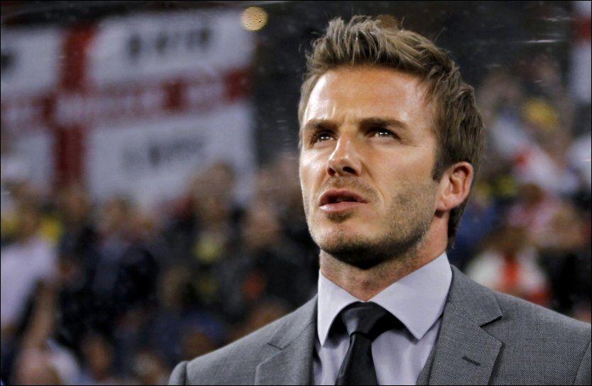 BLE PAFF: David Beckham visste ikke hva han skulle si da en supporter kom seg inn i England-garderoben. Foto: Reuters