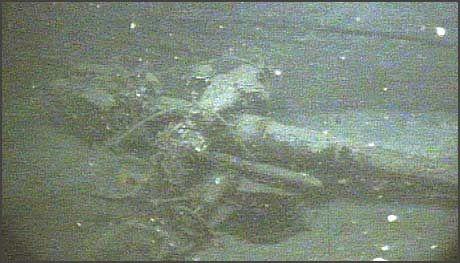 TYSK UBÅT: En 105 mm. kanon fotografert på dekket av vraket til den tyske ubåten U-166, senket av amerikansk marine i 1942. Bildet er tatt av et ubemannet undervannsfartøy. Foto: Scanpix/ C