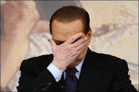 SKAMMER SEG? Silvio Berlusconi etterforkes for tvilsomme handlinger med unge jenter. Foto: AFP