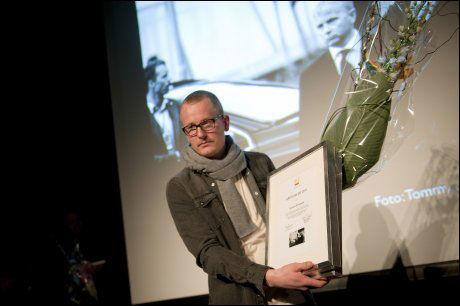 VANT: Frilansfotograf Tommy Ellingsen tok bildet av Jens Stoltneberg og Eskil Pedersen som fanget følelsene etter 22. juli. Foto: Scanpix