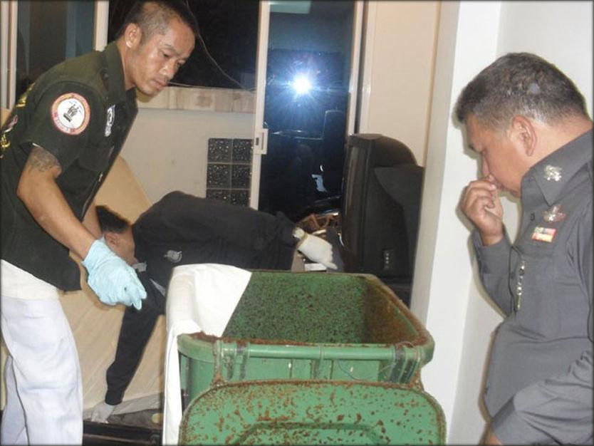 ÅSTEDET: Her jobber thailandsk politi med å undersøke søppelbøtten hvor deler av kvinnen skal ha blitt funnet.