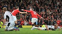 Rooney sikret tre poengs forsprang for United