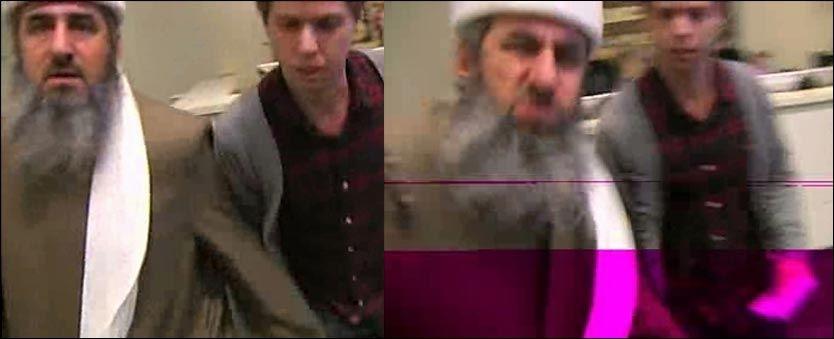 RASENDE: Mullah Krekar ble rasende og gikk til fysisk angrep da han ble spurt om en kommentar fra en TV 2-reporter. Foto: TV 2