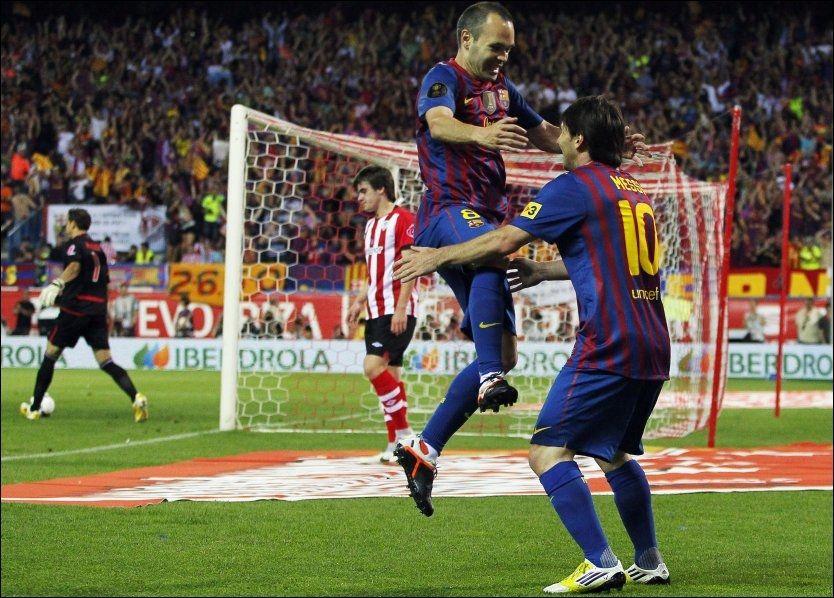 JUBEL Iniesta og Messi jubler etter at Messi scoret for Barcelona mot Athletic Bilbao. Foto: Andres Kudacki / AP