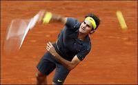 Federer kjempet seg videre