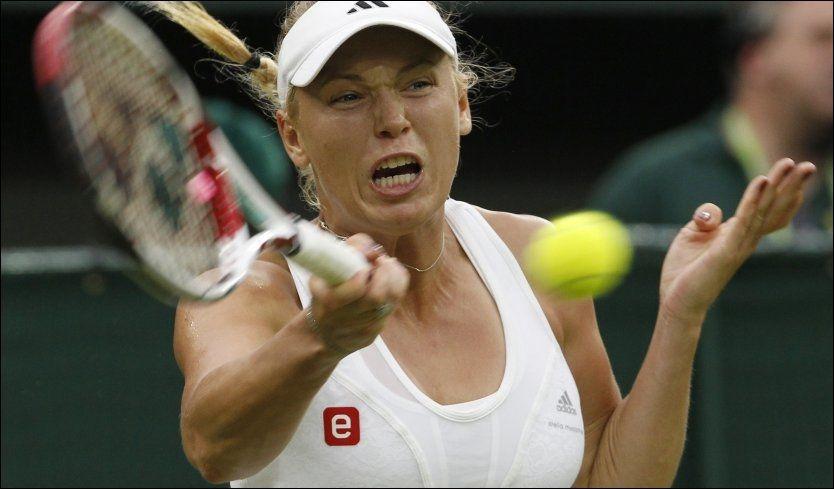 UTE: Caroline Wozniacki er allerede ute av Wimbledon i første runde av turneringen. Foto: Suzanne Plunkett, Reuters
