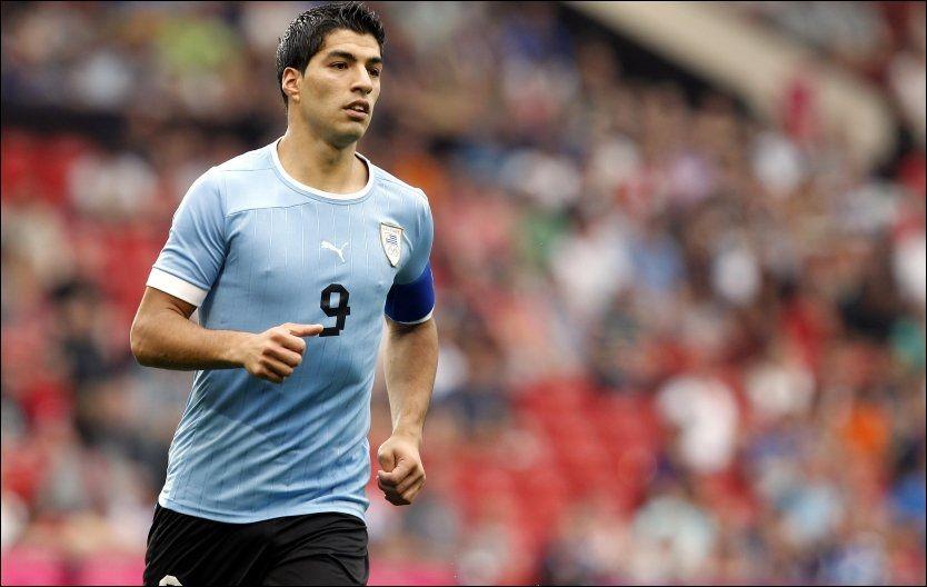 UGGEN VELKOMST: Luis Suarez ble pepet på hver gang han berørte ballen på Old Trafford. Foto: PA Photos