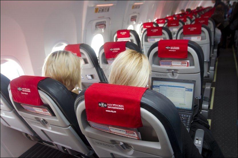 SURFER I LUFTA: Norwegian har som mål at samtlige av selskapets fly skal ha wifi ombord i løpet av året. Foto: SCANPIX