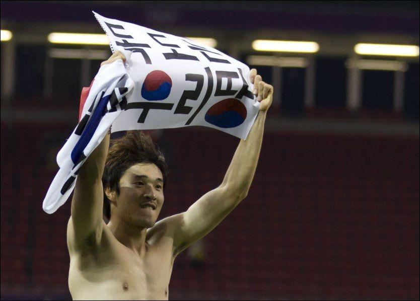 KONTROVERSIELT: Park Jong-woo feiret OL-bronsen med forbudt, politisk budskap. Foto: Scanpix/AP.
