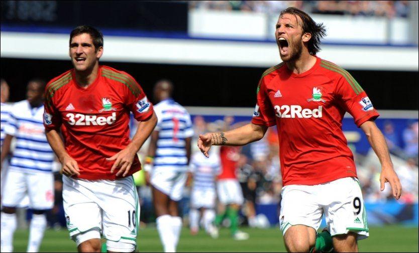 SUPER-DEBUT: Michu (t.h.) introduserte seg for Premier League-publikumet ved å score to mål for Swansea mot QPR i debuten. Til venstre er Swansea-spiss Danny Graham. Foto: PA