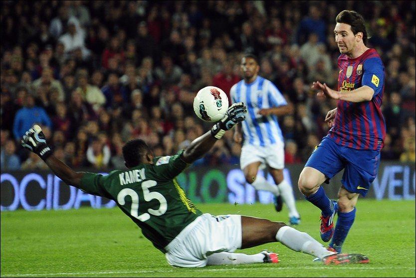 MESSI-VIPPEN: Lionel Messi scorer mot Malaga i mai på Camp Nou. Foto: Manu Fernandez, AP