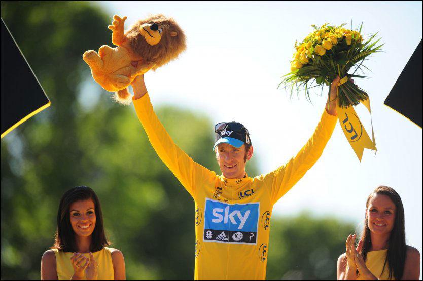 LETTET: Bradley Wiggins er usikker på om han starter Tour-en i 2013. Her er han i Paris 23. juli i år - som rittvinner. Foto: PA