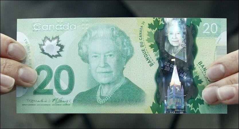 NESTEN NORSK: Lønnebladet på Canadas nye tjuedollarseddel har fått botanikere til å se rødt. Foto: Chris Wattie / Reuters / NTB scanpix