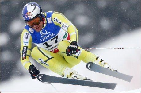 RÅTASS: Aksel Lund Svindal gjorde knapt noen feil fra start til mål under krevende forhold i Schladming. Foto: REUTERS/Dominic Ebenbichler
