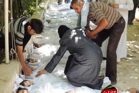DØDE BARN: En borgerjournalist har levert dette bildet av omkomne barn til Local Committee of Arbeen. De har igjen gitt bildet videre til nyhetsbyrået Associated Press. Foto: ASSOCIATED PRESS / NTB SCANPIX