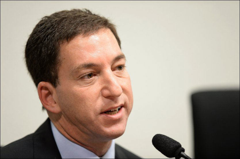 STÅR FAST: Tidligere The Guardian-reporter Glenn Greenwald avviser den norske E-tjenestens forklaring på de avlyttede samtalene Dagbladet omtalte tirsdag. Foto: Afp