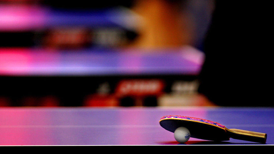 A table tennis bat and ball are seen on a table during training session for the 48th World Table ...