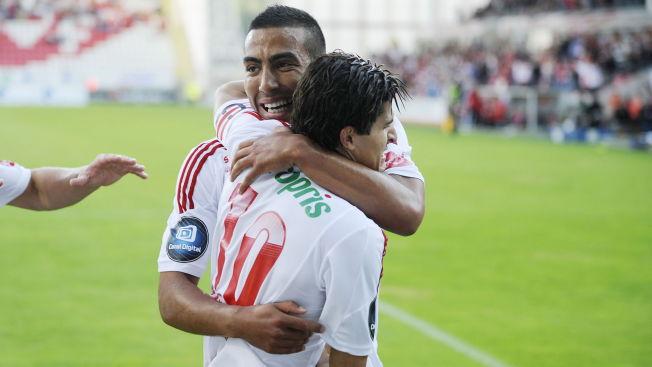 <p>STORE STEG: Haitam Aleesani har tatt store steg siden han spilte i Fredrikstad. Her feirer han mål sammen med daværende medpsiller Tarik Elyounoussi, som nå er i tyske Hoffenheim.</p>
