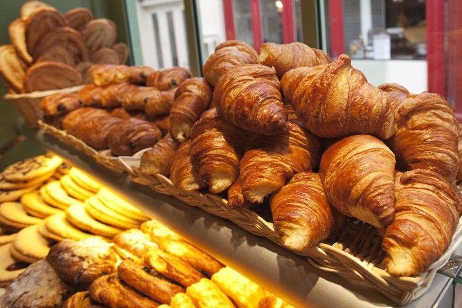 Croissants and pastries display in a Patisserie shop