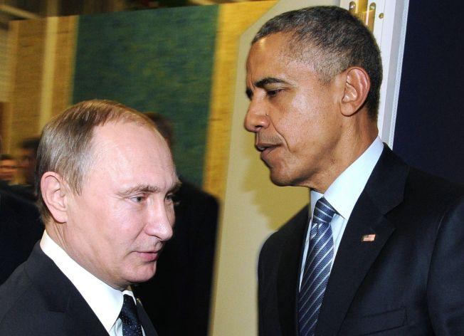 MEKTIG MØTE: USAs president Barack Obama og Russlands president Vladimir Putin diskuterte storpolitikk i forbindelse med klimatoppmøtet mandag.
