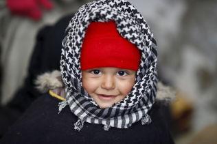 <p>RØMT FRA KRIG: En syrisk gutt er fotografert i flyktningleiren på de syriske siden av grenseovergangen Bab al-Salam mellom Syria og Tyrkia.<br/></p>