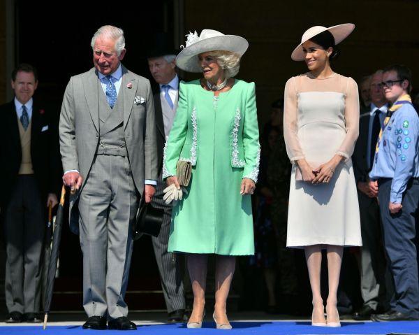 MED BURSDAGSBARNET: Her er Meghan Markle (t.h.) sammen med Camilla Parker Bowles og jubilanten prins Charles. Foto: AFP.